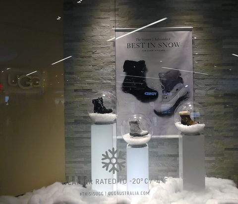Window display with internally lighted pedestals creates a visually stunning showcase to engage shoppers.