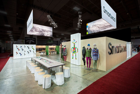 The Smartwool booth benefits from cross traffic at an intersection in the tradeshow walkways.