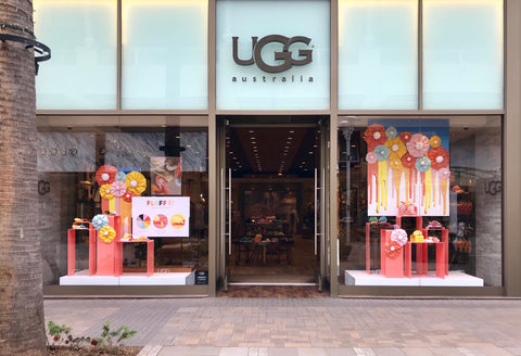 Ugg boots spring lineup in colorful window display.