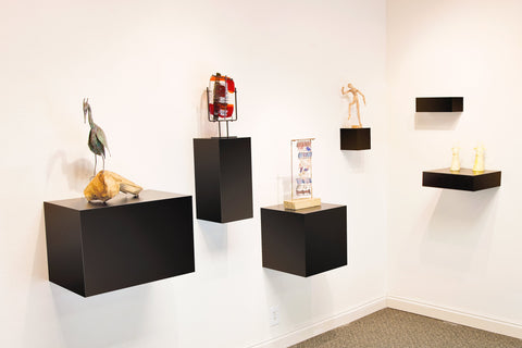 Floating shelves turn any wall into art displays.