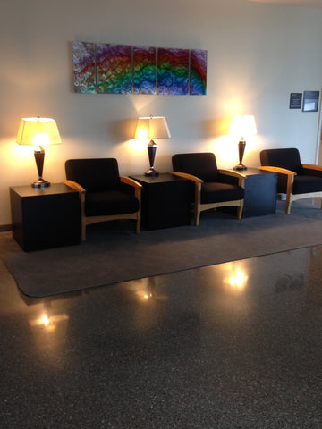 Side tables and lamp stands in office lobby