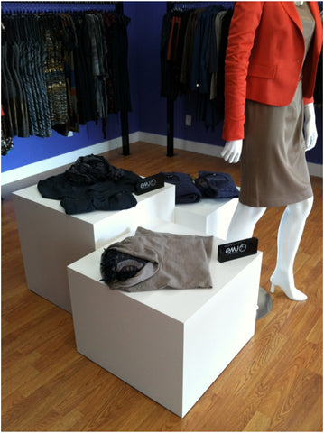White laminate cube tables for retail display