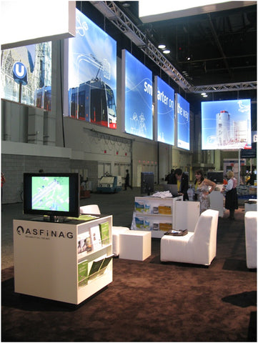 White laminate cube tables in trade show booth