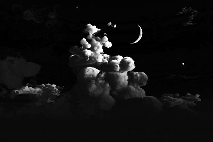 black and white image of tall, fluffy clouds with a crescent moon, Jupiter, and Saturn.