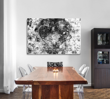 "Load image into Gallery viewer, Large metal print over a wood table. Black Lives Matter. Black and white abstract with a gray heart, a mix of paint splashes, and the text ""black lives matter"" spread through out."