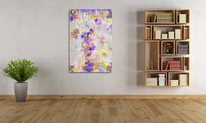 Metal print in large room with a plant and bookshelves. Abstract tha tlooks like old layers of paint, with cracks. Green, silver, blue, yellow, orange, and pink.