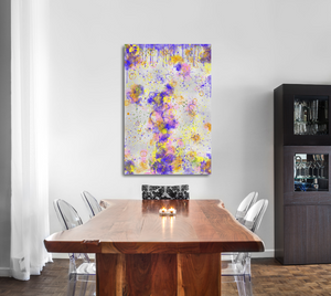 Metal print in a dining room. Abstract tha tlooks like old layers of paint, with cracks. Green, silver, blue, yellow, orange, and pink.