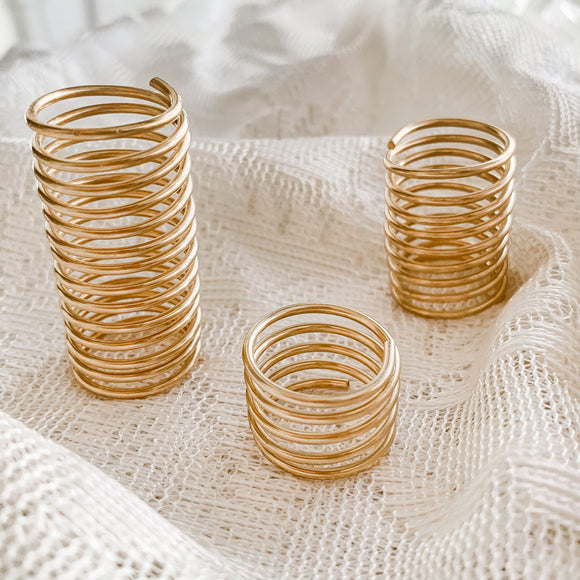 Brass spiral display stands for small minerals and crystals.