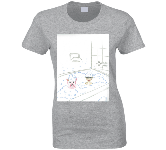 image shows a light coloured t-shirt with a cartoon image of a little boy and a pig in a bubble bath.