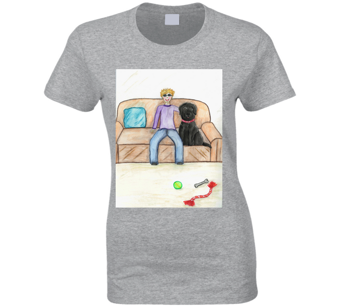 image shows a light coloured t-shirt with a cartoon image of a  boy and a dog sitting on a couch