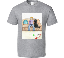 Load image into Gallery viewer, image shows a light coloured t-shirt with a cartoon image of a  boy and a dog sitting on a couch