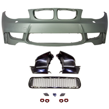 photo of front bumper with parking sensor holes, with mesh grille and miscellaneous parts