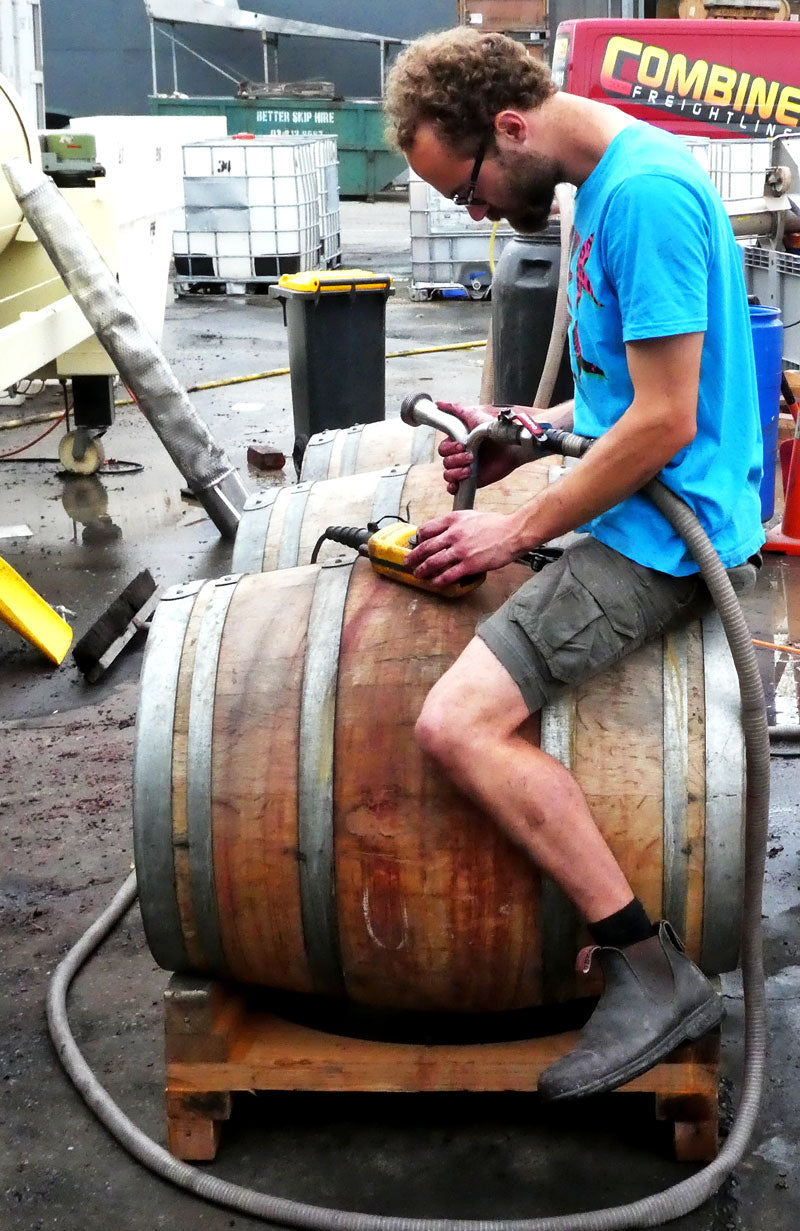French winemaker François Robichon filling a barrel with 2016 red wine at Pegasus Bay