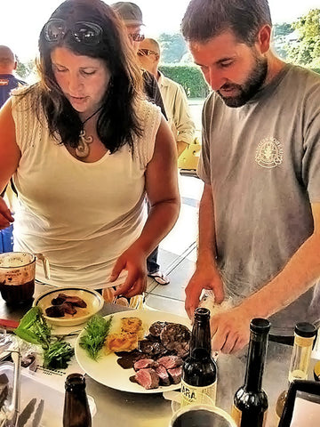 Winemaker Jannine and Haydon Good (winemaker from Crater Rim) prepare food at the Local Wild Food Challenge.