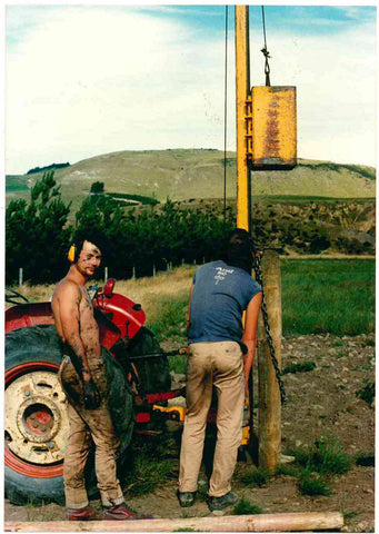 It was a hot summer day in 1988 when this photograph of Matthew Donaldson, now our winemaker, was taken, with Mount Cass (solid limestone) in the background. He is shown with a friend (Sean Harper – back to the camera) driving posts in the Pegasus Bay Vineyard during their secondary school holidays.