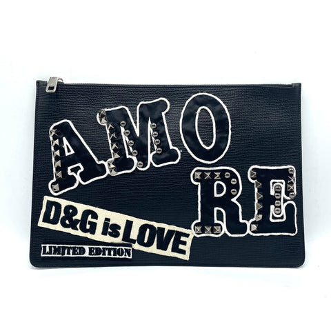 Dolce & Gabbana leather clutch bag with patch and studs