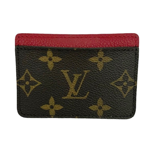 Louis Vuitton card holder in Monogram canvas and red cowhide lining