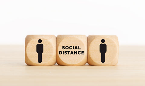 social distancing written on a dice
