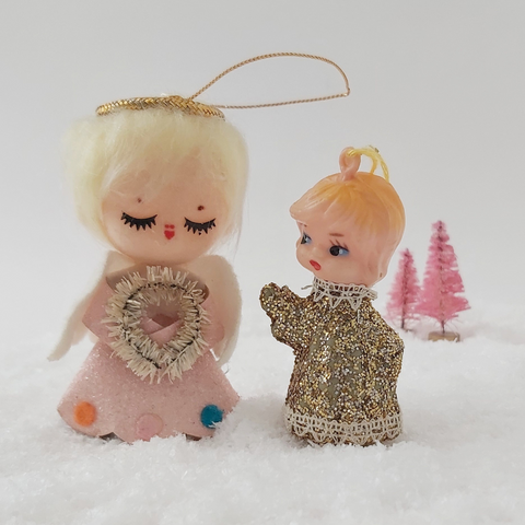 two mid century style angel ornaments, standing side by side