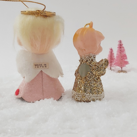 Back view of two mid century style angel ornaments