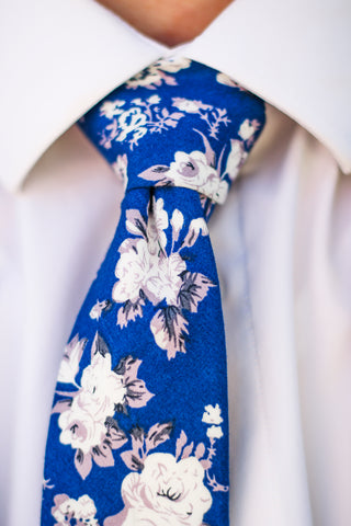 A bold blue and white floral tie. Ty's Tiess where Ties Are Made For Life's Biggest Moments