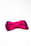 Knitted pink and black bow tie