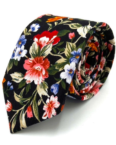 Dusty Floral Tie. Here at Ty's Tiess we specialize in handmade ties, trendy ties, wedding ties, and ties for teenagers. As a Utah tie shop it is our priority to custom design the best ties you'll ever see.