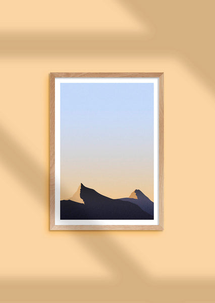 Framed minimal gradient print inspired by the early morning light on the mountain tops of Geiranger, Norway on a warm yellow background.