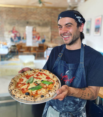 Stefano, from Scream For Pizza, with a freshly cooked pizza.