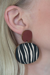 Kivi earrings in use, maroon