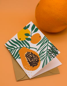 Hedelmät mini greeting card and an orange