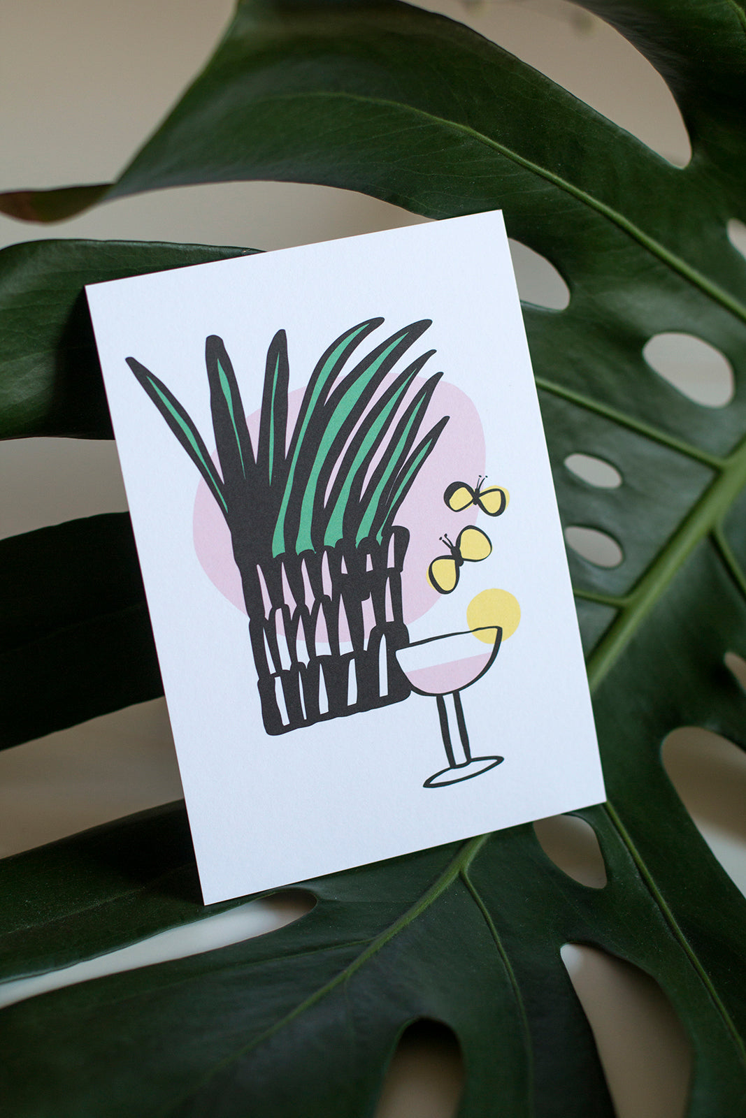 Drinkki postcard and a monstera leaf