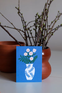 Kukkamaljakko postcard and a vase