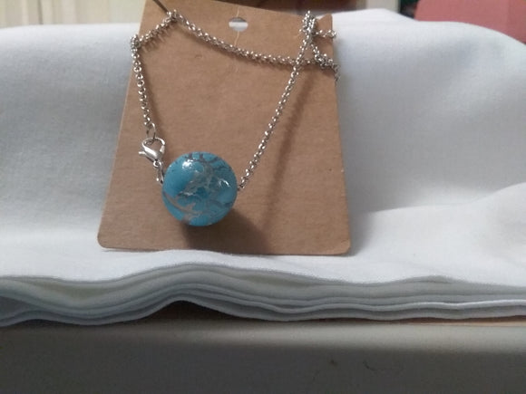Silver necklace with blue bead ball