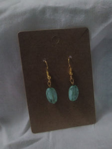 Blue and whitecolored oval handmade earrings.