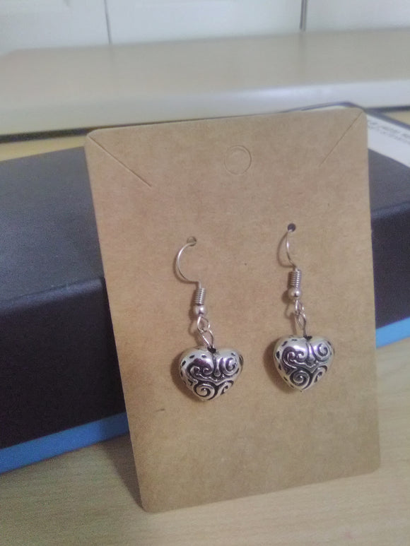 Silver heart earrings . Handmade.