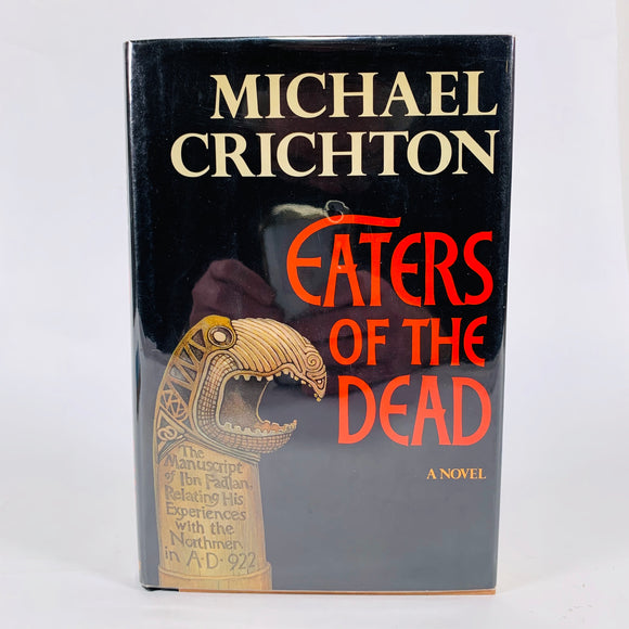 Crichton, Michael. Eaters of The Dead [inscribed first edition]