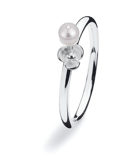 Sterling silver ring with fresh water pearl and flower setting.