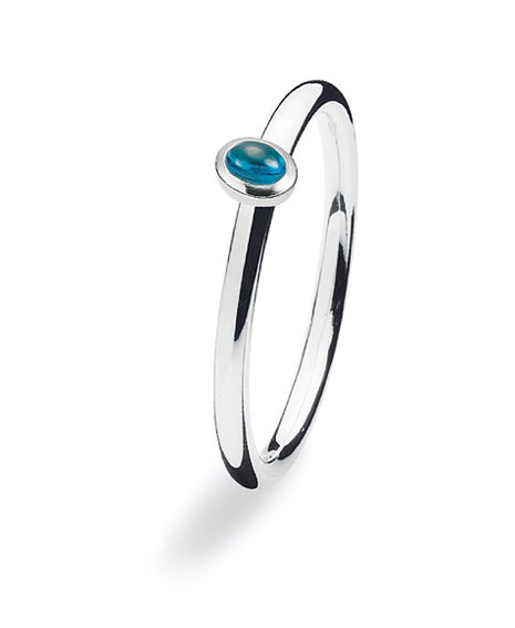 Sterling silver ring with blue cubic zirconia setting.