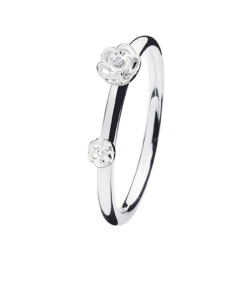 Sterling silver ring with cubic zirconia flower settings.