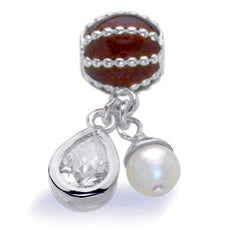 Necklace and bracelet charm in sterling silver with cubic zirconia and freshwater pearl.