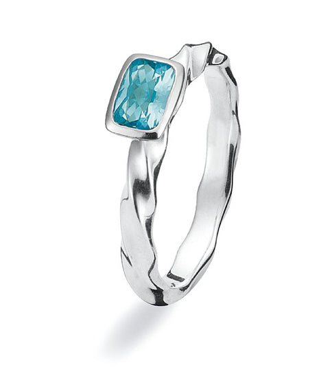 Sterling silver ring with blue synthetic stone setting