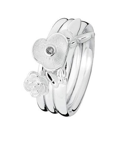 Sterling silver ring combination featuring floral motif, butterflies and cubic zirconia