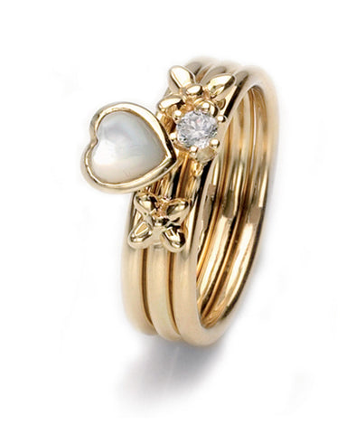 9ct gold ring combination featuring mother-of-pearl and cubic zirconia