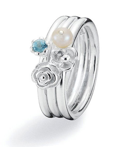 Sterling silver ring combination featuring blue cubic zirconia and freshwater pearl