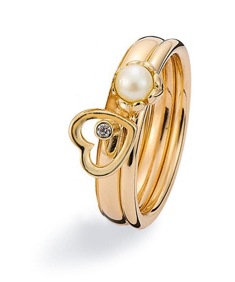 9 carat gold Spinning Jewelry combination featuring cubic zirconia and freshwater pearl.