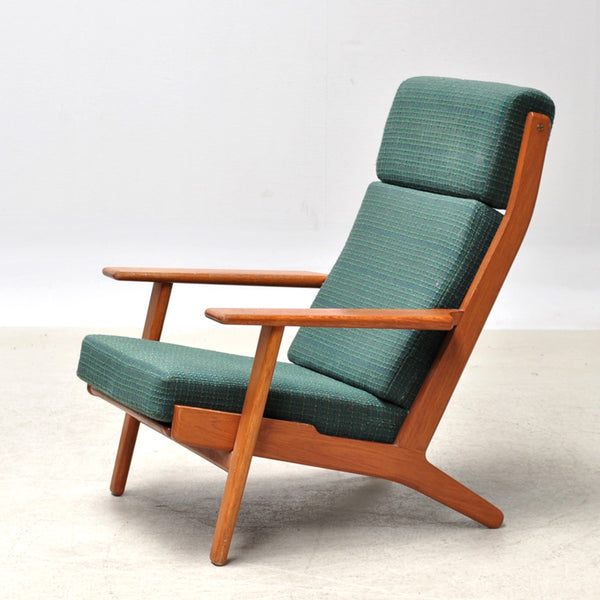Vintage Hans Wegner high back lounge chair in teak with original green fabric upholstery. Designed in 1953 and made by Getama, Denmark.