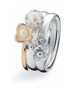Sterling silver ring and 9 ct gold ring combination featuring freshwater pearls