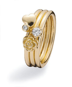 Ring combination with 9 ct gold and cubic zirconias in heart and flower settings