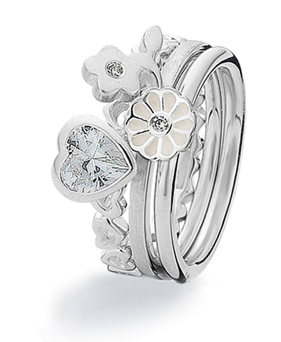 Sterling silver ring with heart and flower cubic zirconia settings